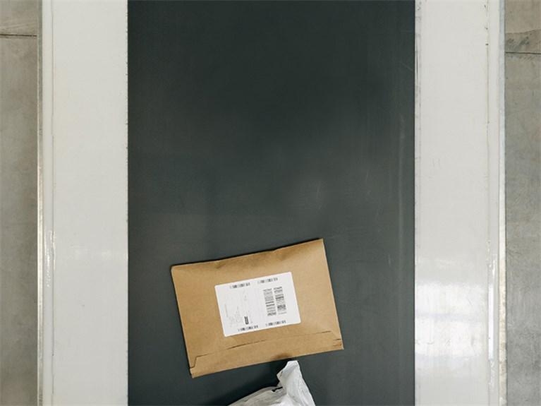 Customs import changes parcels on a conveyor belt